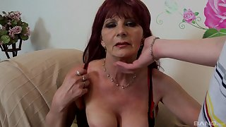 Sex from behind is the favorite sex pose of redhead mature lady