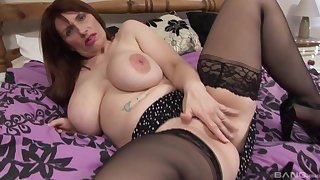 Mature brunette with saggy gut strips and gets dirty surpassing the bed
