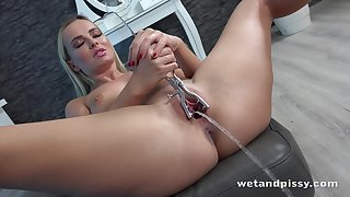 Stunning babe Victoria Pure is pissing and playing upon her wet snatch