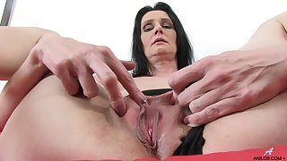 Video of grown-up slut Laura Dark playing with a large purple dildo