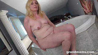 Homemade solo video of a small chest blondie fingering her cunt